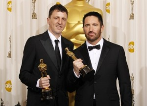 Atticus Ross and Trent Reznor pose backstage at the 83rd Academy Awards in Hollywood